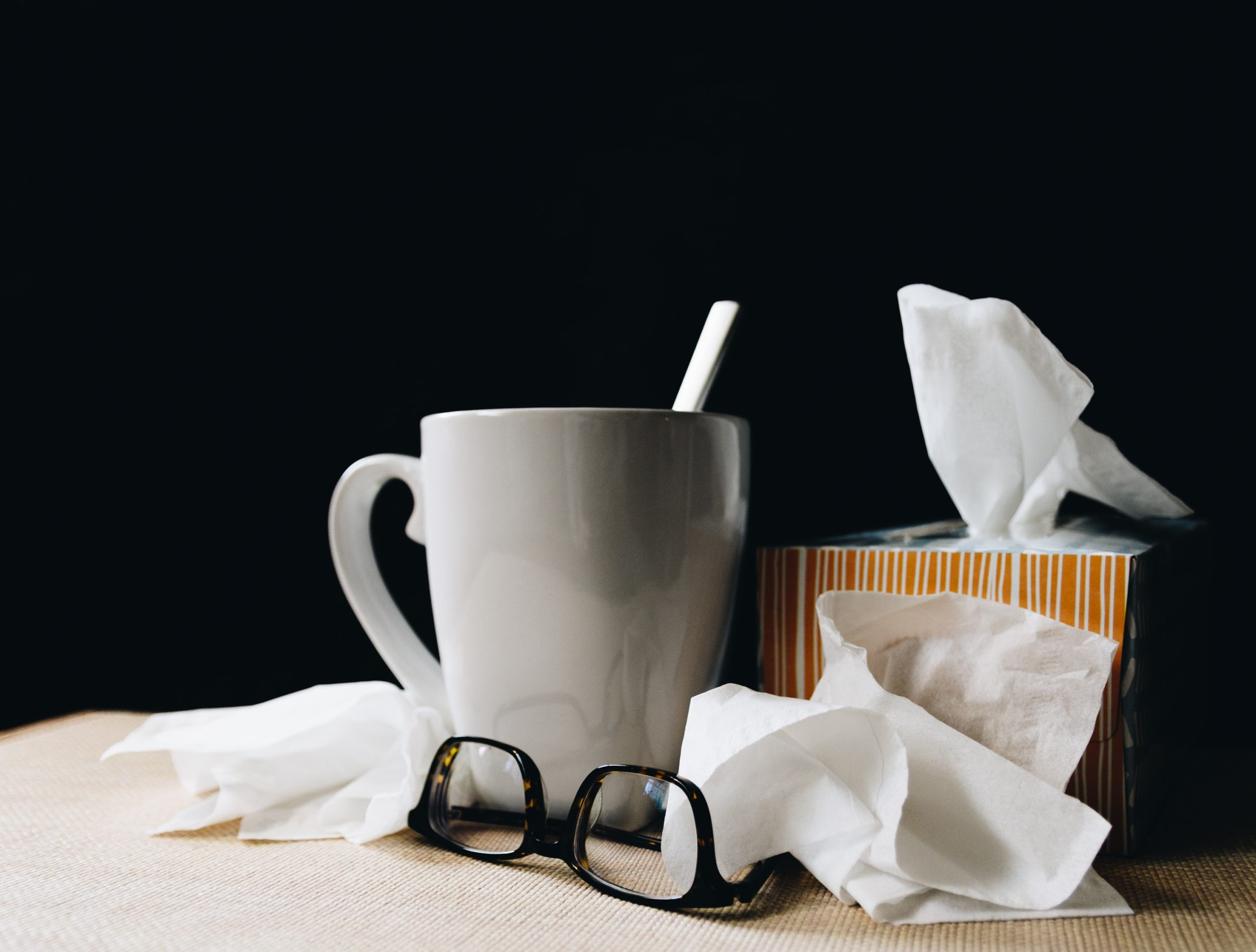 Mug with tissues and glasses