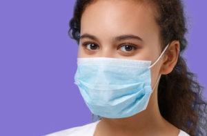 Woman wearing type IIR face mask